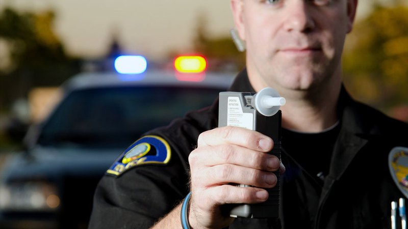 Policeman with breathalyser